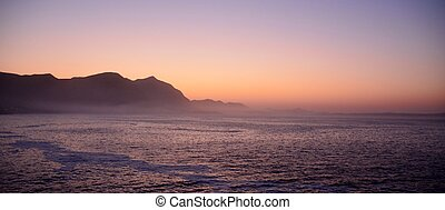Dawn - Seascape with sea and mountains at dawn