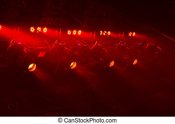 Red light - Powerful spotlights illuminate the scene with...