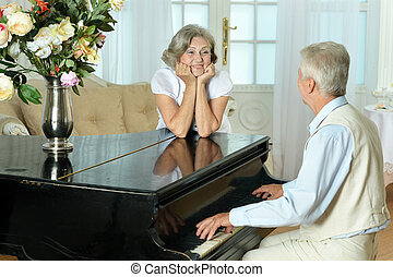 Beautiful elderly couple at home