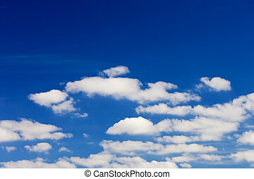 blue sky background - blue sky with white fluffy clouds...
