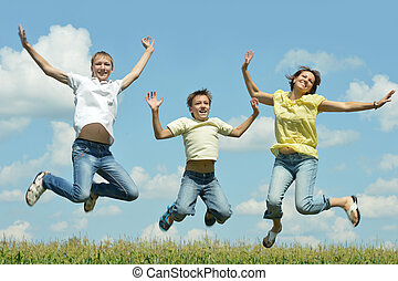 Mother and children jumping