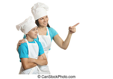 Female chef with assistant pointing at copy space