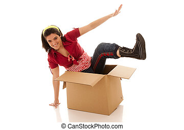 Jumping outside of the box - young woman leaving from a...