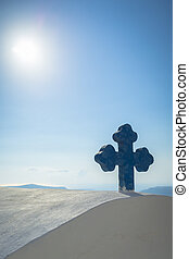 Blue Cross in Santorini - A blue cross on top of a Chapel...