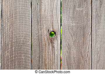 rough wooden fencing with knot hole - rough wooden fencing...