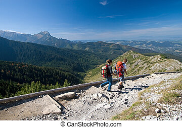 Trekking in mountains - Couple is trekking in mountains...