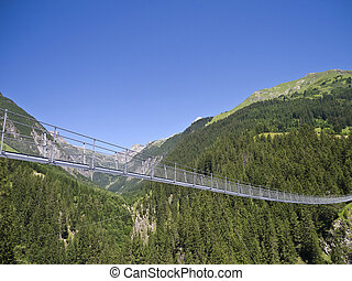 swing bridge - the swing bridge leading over a valley in the...