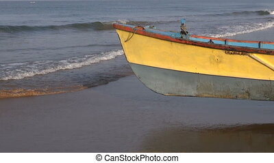 colorful wooden boat on Arabian sea coast, Karnataka, India...