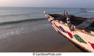 colorful wooden boat on Arabian sea coast, South India