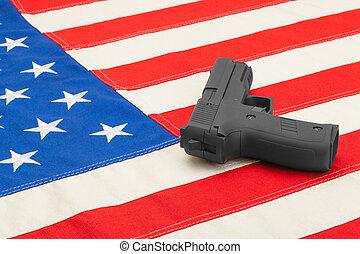 Gun laying over USA flag - studio shoot