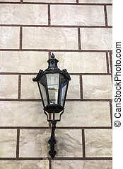 Old street light closeup on the wall