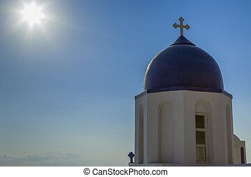 Sunshine on the Chapel at Skaros - Sunshine lights the blue...