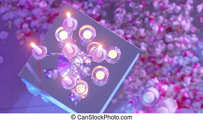 Burning candles in mirror - Group of burning candles cage on...
