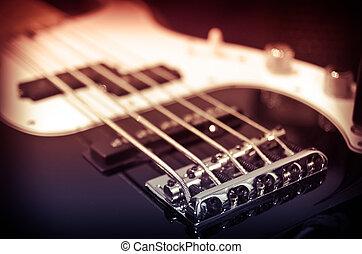 electric guitar - electric bass guitar in a studio closeup