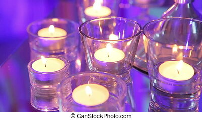 Burning candles - Group of burning candles cage on mirror