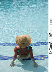 woman relaxing at the pool