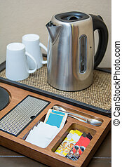 percolator with coffee and sugar, facilities in hotel's room