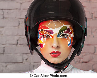 Model with bright creative make up with helmet - Portrait of...