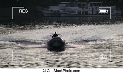 Man in a motorboat on the river