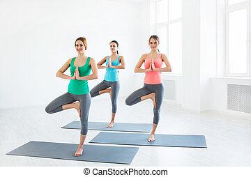 Yoga - Young girls do yoga indoors