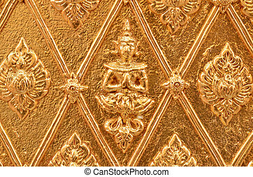 Buddha carved gold wall