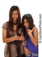 Teenager sms addiction - young beautiful sisters using the...