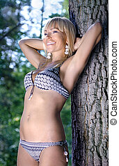 recreation in the forest - beautiful woman in underwear is...