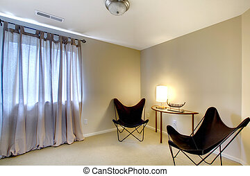 Room corner with two modern chairs and table