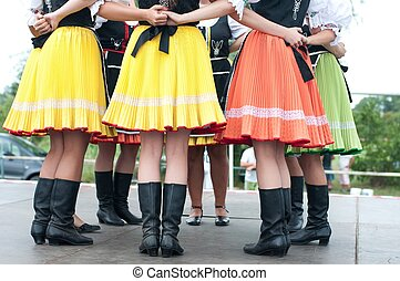 Fragment of Slovak folk dance with colorful clothes in Folk...