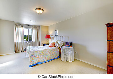 Bright bedroom with anitque iron frame bed