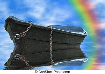 Abandoned rowboat and rainbow sky