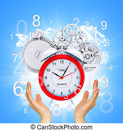 Hands hold alarm clock with figures and gears. Blue...