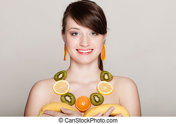 Diet. Girl with necklace of fresh citrus fruits - Diet. Girl...
