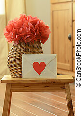 Vase basket with red tissue paper flower-pom pom, and...