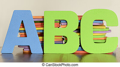 Colorful letters A, B, C in a row of fltat foam letter toys