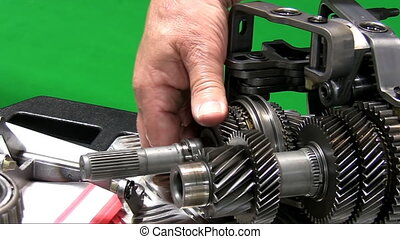 Dismantling car gearbox 4. Teacher - Hand of man is showing...