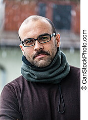 Man in winter - a balding man with moustaches wearing winter...