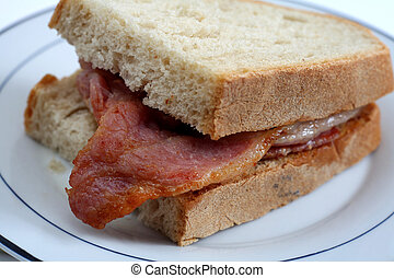 Bacon sandwich close-up - A bacon sandwich, with...