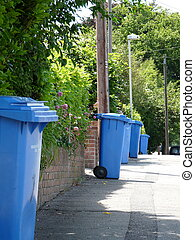 waste bins awaiting collection - blue wasre bins awaiting...