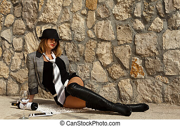 drunk girl lies posing on stone - drunk girl in jack boots...