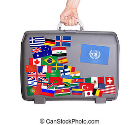 Used plastic suitcase with stickers - Used plastic suitcase...