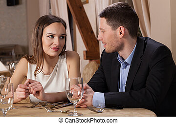 Couple looking into each others eyes in a restaurant