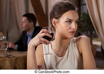 Single woman drinking wine - Single woman drinking red wine...