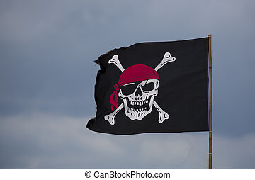 Pirate flag on a blue sky