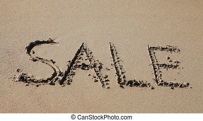 "Word ""Sale"" drawn in the sand - Word ""Sale"" deleting ocean..."
