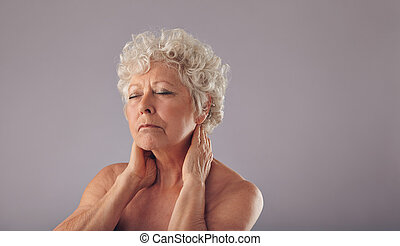 Senior woman with neck pain - Portrait of mature woman...