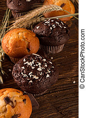 muffins - fresh muffins with nature background. Corn field