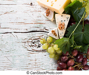 wine, drink - Wine and cheese on wooden table with fresh...