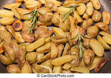 Rosemary potatoes in a frying pan