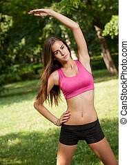 Fit beauty - Fit young teen girl outside in the sunlit park...